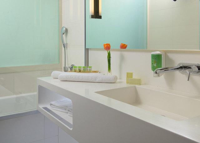 bathroom sink property countertop plumbing fixture vessel bathtub flooring bidet tub toilet Bath