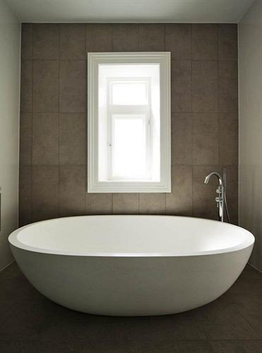 bathroom bathtub plumbing fixture sink bidet toilet flooring tub water basin tile tiled Bath stone