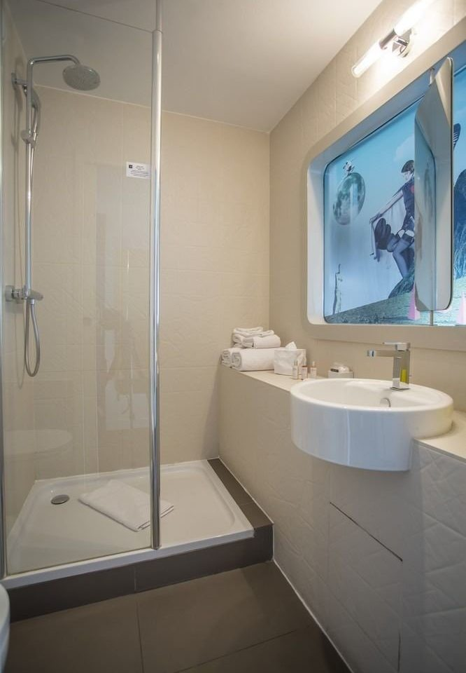 bathroom mirror sink property plumbing fixture white home toilet bidet bathtub tub tiled tile Bath