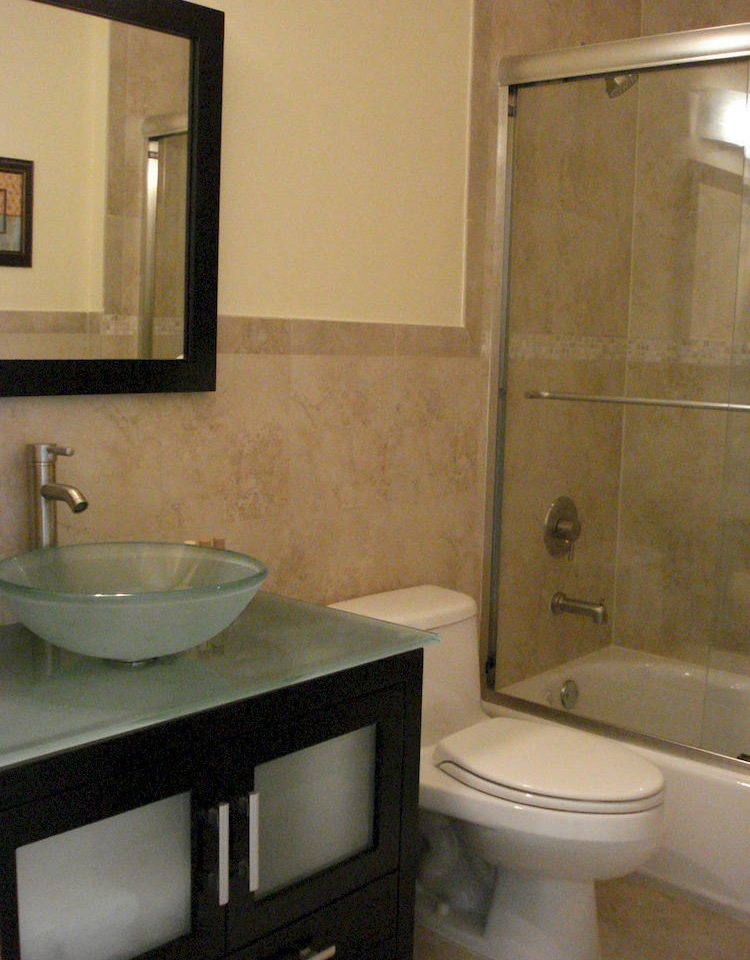 bathroom sink toilet mirror property home plumbing fixture bidet flooring tub Bath bathtub