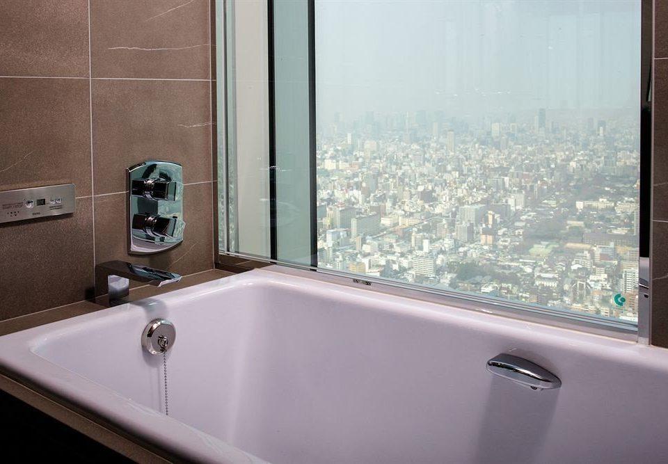 bathroom vessel mirror property sink bathtub swimming pool plumbing fixture tub flooring bidet jacuzzi Bath tile water basin tiled