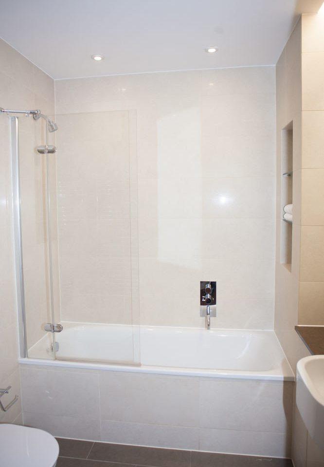 bathroom property tub plumbing fixture bathtub white toilet bidet Bath tile tiled