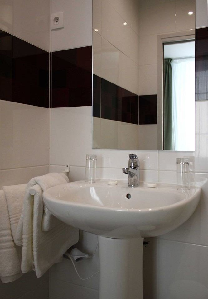 bathroom sink property white bidet plumbing fixture toilet flooring tile tiled tub Bath bathtub