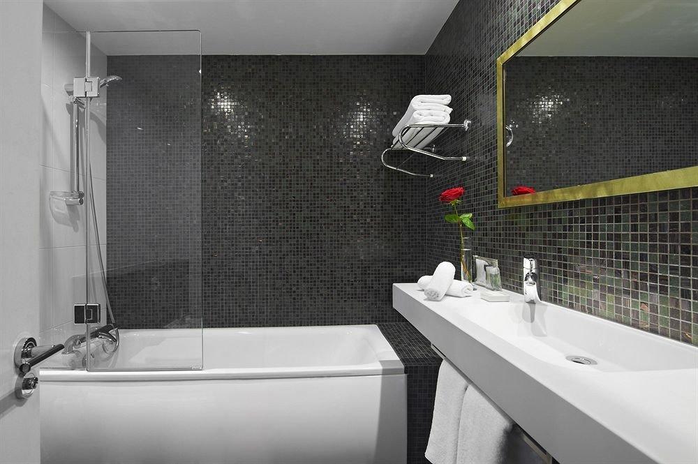 bathroom sink toilet bathtub plumbing fixture vessel tile bidet flooring swimming pool tiled tub Bath