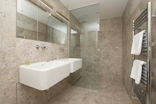 bathroom property sink home flooring plumbing fixture bathtub public toilet tile bidet tiled tan Bath