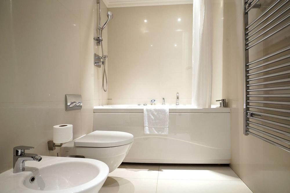 bathroom toilet property sink white home plumbing fixture bathtub bidet vessel tub Bath tile