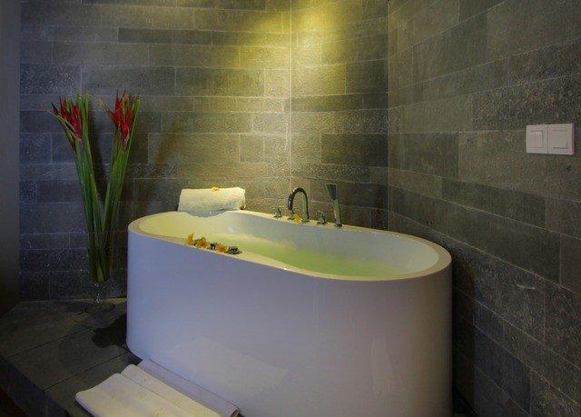 bathtub bathroom swimming pool plumbing fixture bidet public toilet tub Bath tiled
