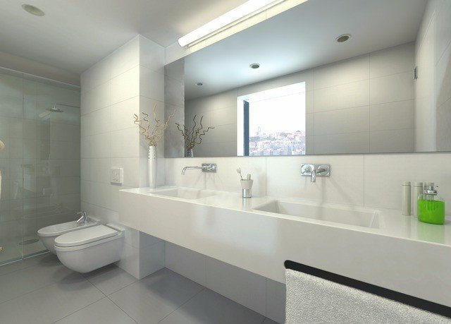 bathroom mirror sink property plumbing fixture bathtub flooring bidet toilet tub clean tile Bath
