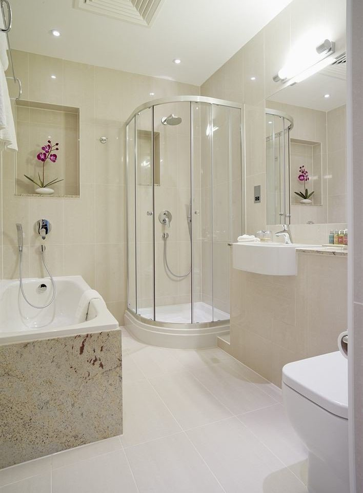 bathroom toilet property vessel sink plumbing fixture white shower bidet flooring tub bathtub Bath tile tiled