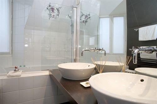 bathroom sink toilet property bidet tub bathtub plumbing fixture Bath tiled tile