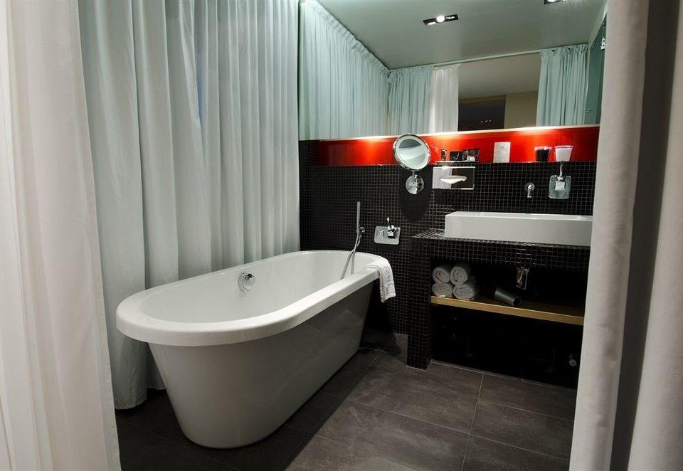 bathroom curtain property sink white bathtub tub plumbing fixture bidet Bath tile tiled
