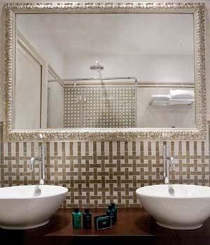 bathroom sink bowl plumbing fixture tile flooring bathtub bidet Bath tub tiled
