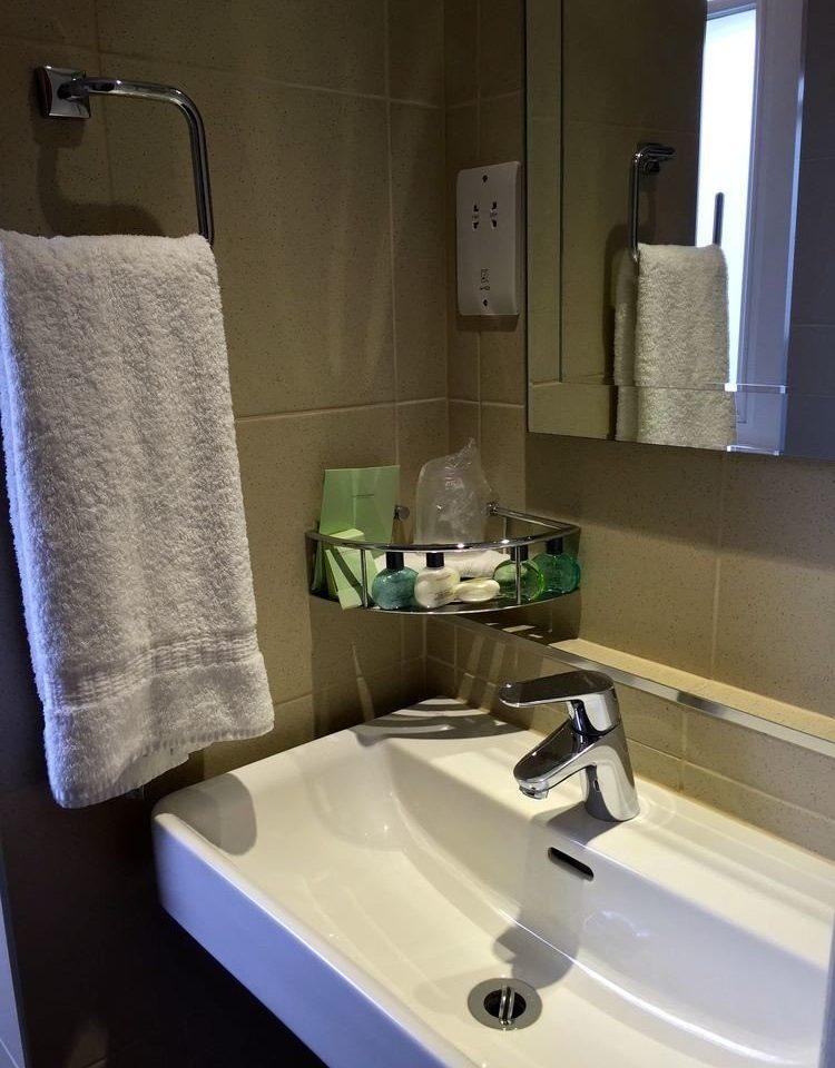 bathroom sink mirror towel plumbing fixture toilet home swimming pool bidet flooring bathtub tub Bath