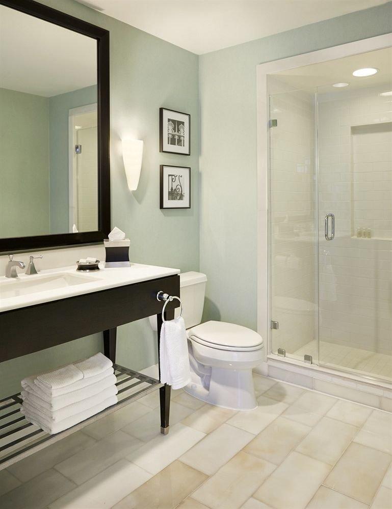 bathroom mirror sink property plumbing fixture flooring white bathtub bidet tile rack Bath