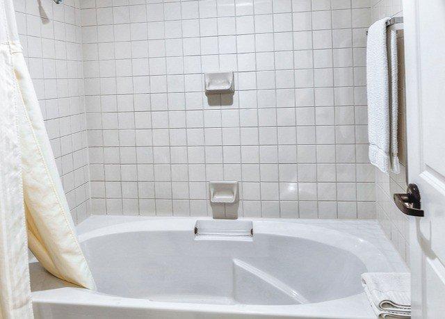 bathroom vessel bathtub plumbing fixture toilet tub bidet swimming pool Bath tiled tile