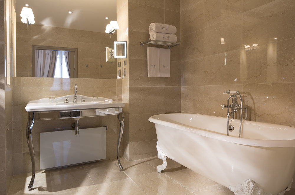 bathroom toilet bathtub plumbing fixture bidet home sink flooring vessel tub Bath tile tan tiled