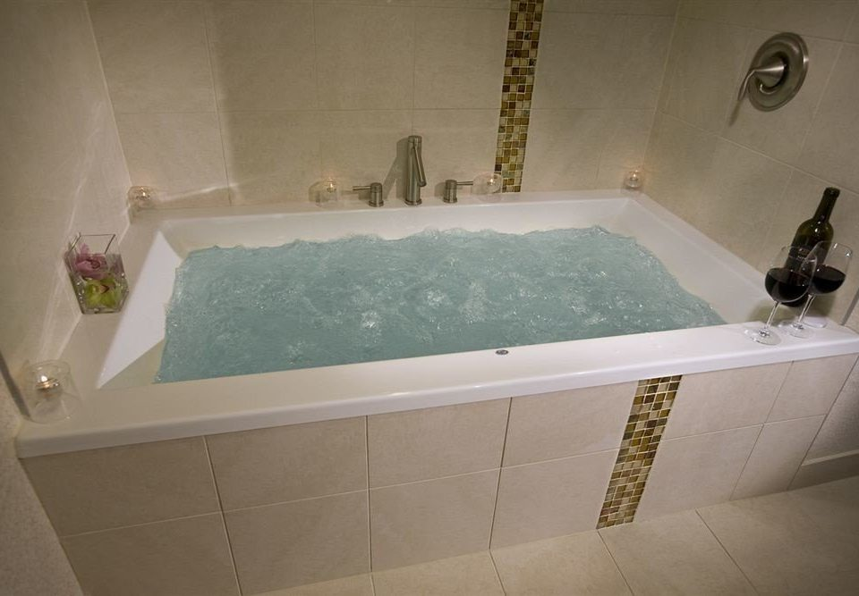 vessel bathtub bathroom swimming pool property plumbing fixture jacuzzi sink flooring tile bidet tiled Bath