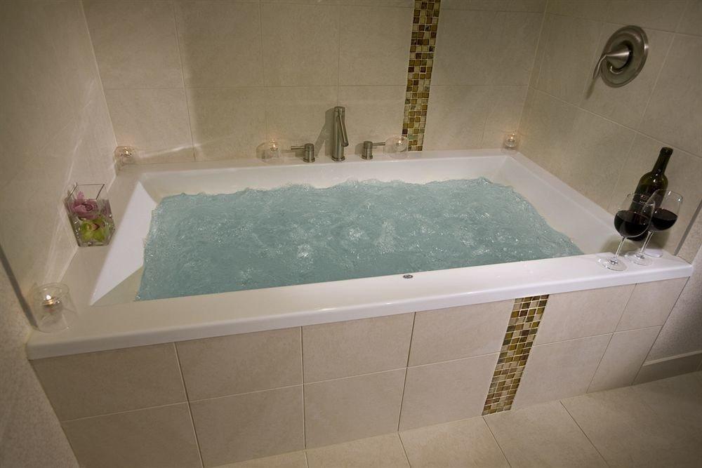 vessel bathtub bathroom swimming pool property plumbing fixture jacuzzi sink flooring tile bidet tiled Bath