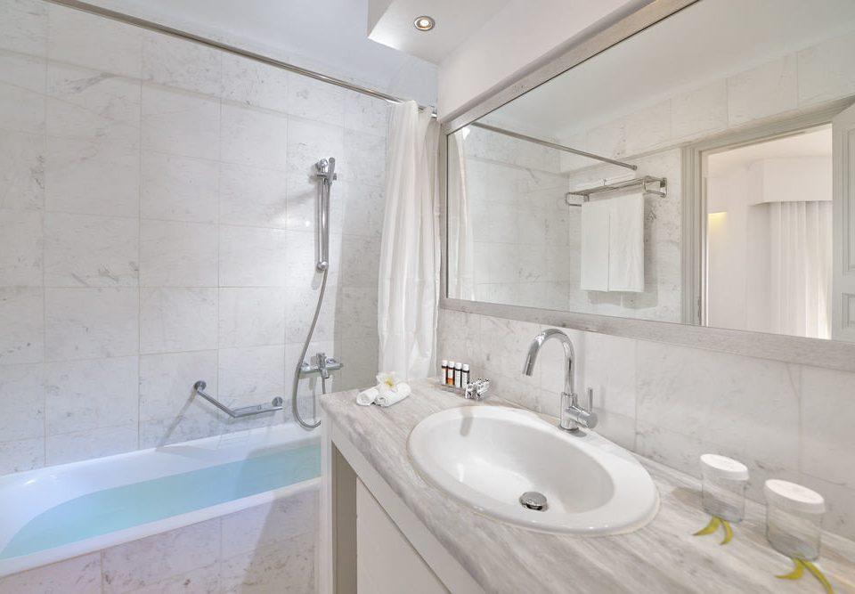 bathroom property sink bidet tub plumbing fixture flooring bathtub toilet tile Bath tiled