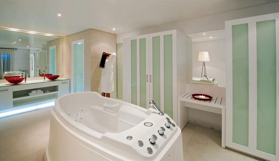 bathroom property white bathtub toilet home sink bidet plumbing fixture tub Bath