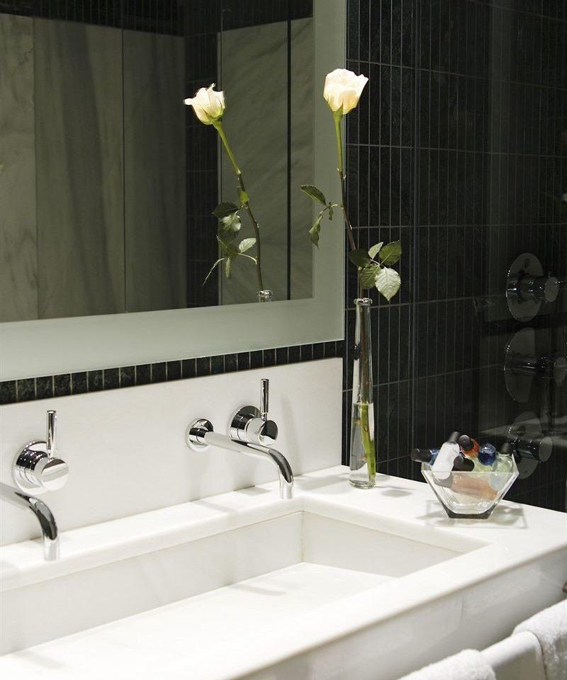 bathroom mirror sink white bathtub plumbing fixture bidet towel ceramic tap tile long Bath