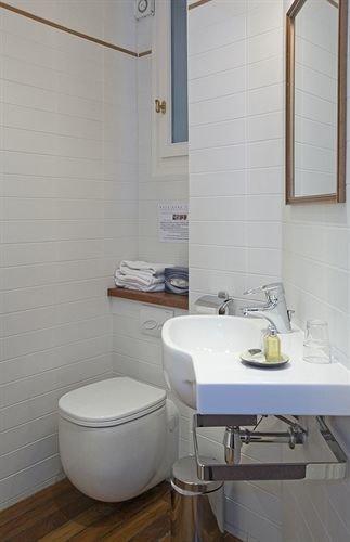 bathroom sink toilet property bidet plumbing fixture bathtub flooring tile tiled Bath
