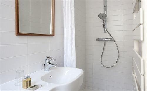 bathroom sink plumbing fixture bidet bathtub flooring toilet tile tiled Bath