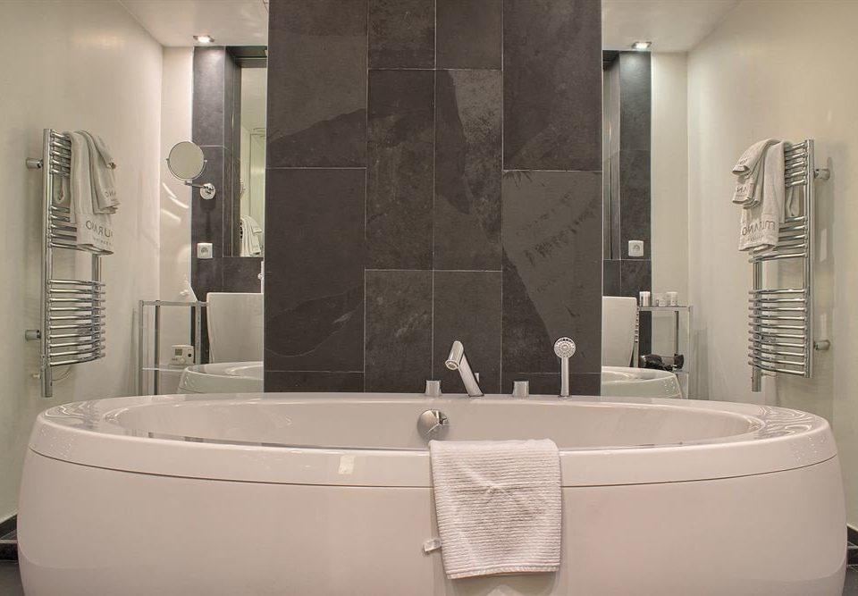 bathroom bathtub toilet plumbing fixture sink white bidet public toilet flooring tub Bath