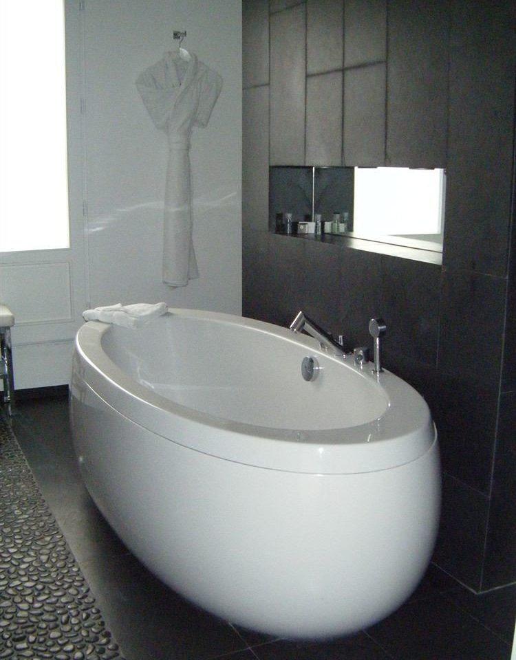 bathroom toilet bathtub plumbing fixture bidet swimming pool white jacuzzi toilet seat tile tiled Bath