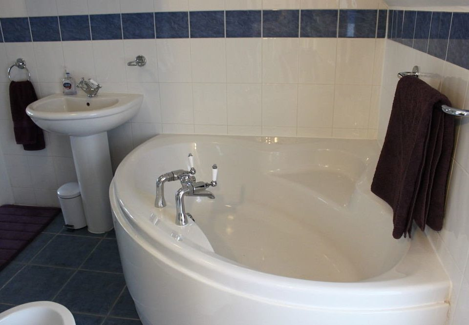 bathroom toilet property bathtub white bidet plumbing fixture sink tile tiled tub water basin Bath