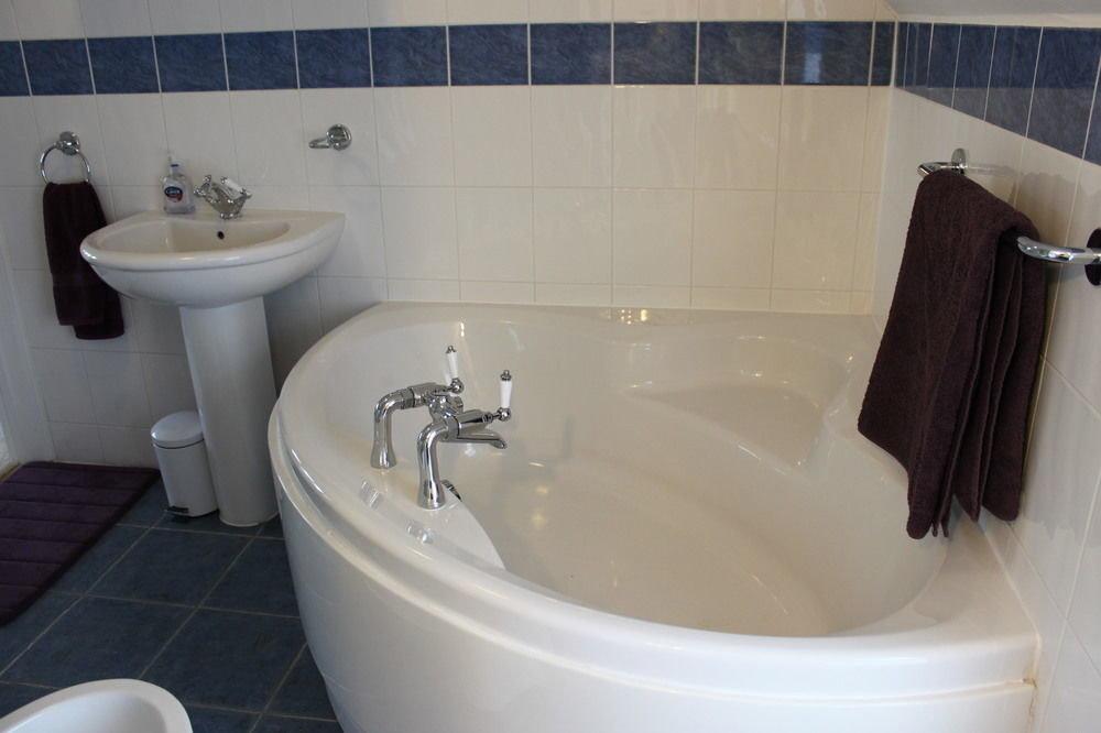 bathroom toilet property bathtub white bidet plumbing fixture sink tile tiled tub water basin Bath