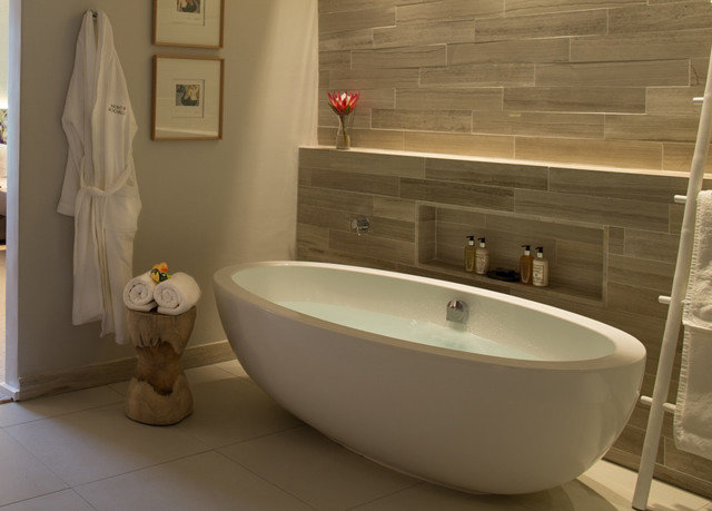 bathroom bathtub vessel sink plumbing fixture bidet flooring white swimming pool toilet tub Bath tile
