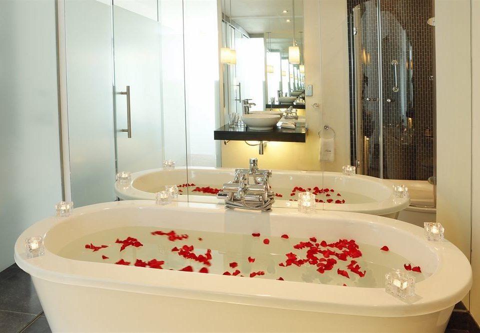 bathroom sink bathtub swimming pool plumbing fixture jacuzzi toilet white bidet tub vessel Bath water basin tile tiled