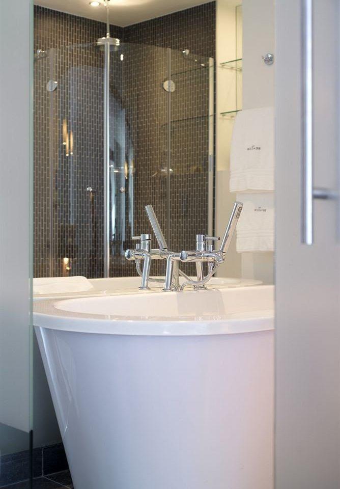 bathroom bathtub plumbing fixture toilet white sink bidet tiled tile tub Bath