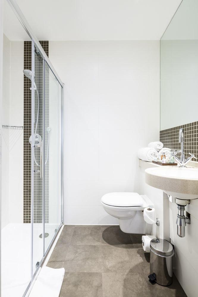 bathroom sink property toilet bidet flooring home plumbing fixture tile Bath tub bathtub tiled