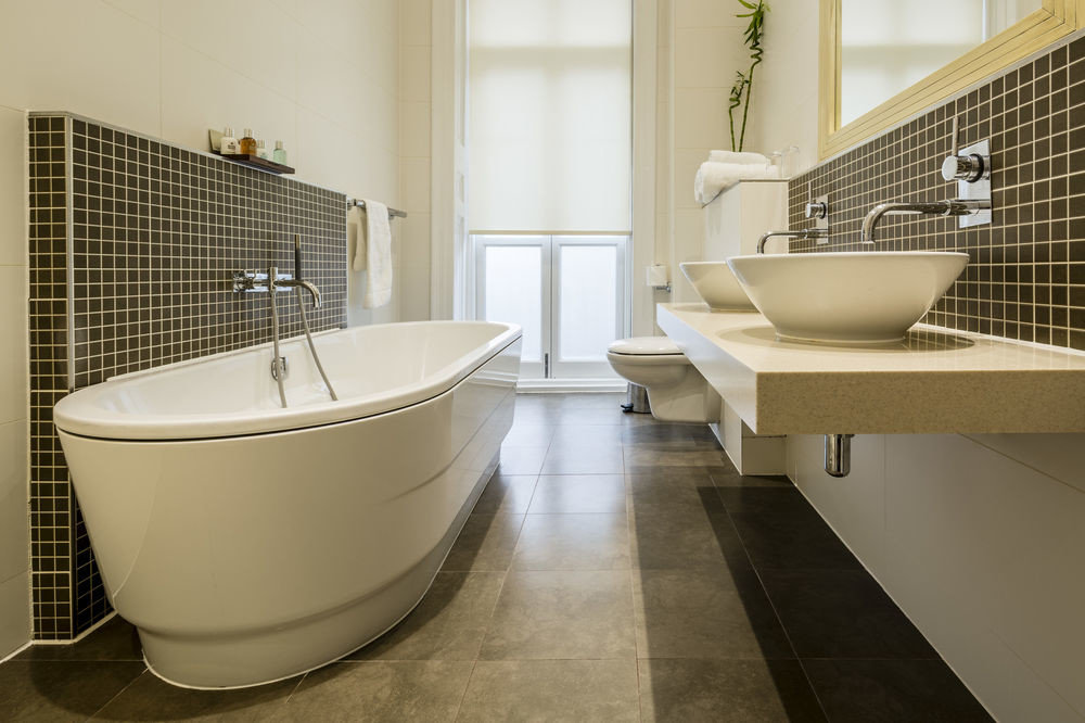 bathroom bathtub flooring plumbing fixture tile bidet sink tiled Bath tub