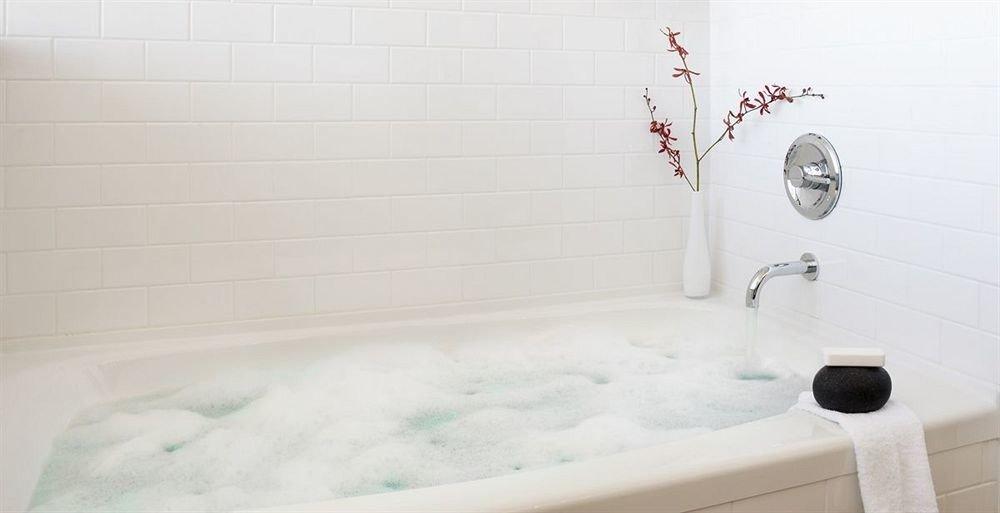 bathtub bathroom toilet plumbing fixture flooring bidet tile Bath tiled