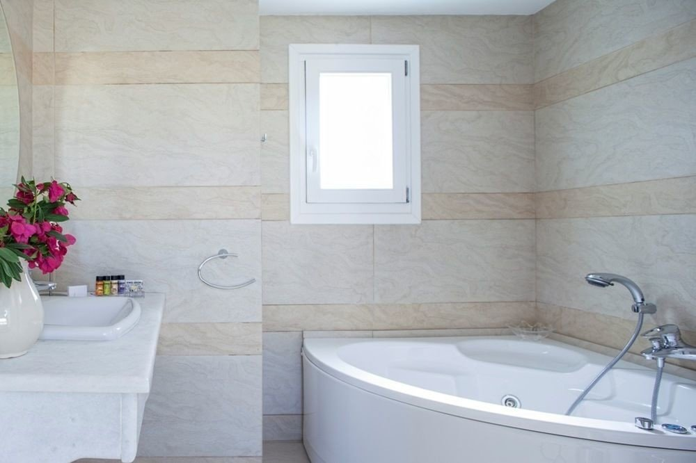 bathroom property vessel bathtub tub sink bidet plumbing fixture white flooring Bath water basin tiled