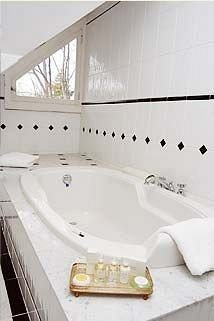 bathroom bathtub swimming pool vessel jacuzzi plumbing fixture bidet sink tile tub Bath tiled
