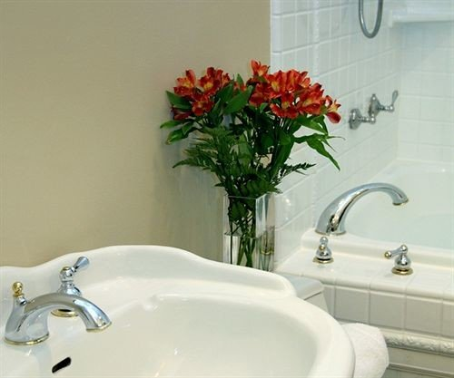 bathroom sink bathtub toilet bidet vessel plumbing fixture swimming pool tap flooring water basin Bath