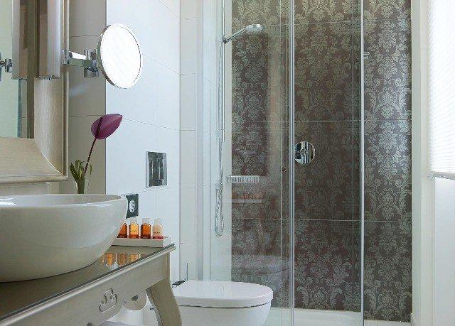 bathroom property plumbing fixture flooring home tile sink bathtub bidet tub Bath tiled