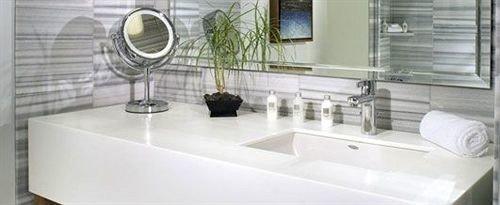 bathroom property sink bathtub home plumbing fixture flooring tile bidet toilet tub Bath