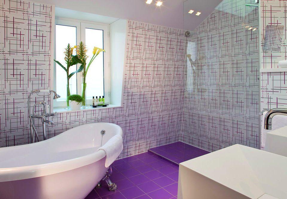 bathroom property vessel bathtub tub tiled swimming pool plumbing fixture bidet toilet tile Bath water basin