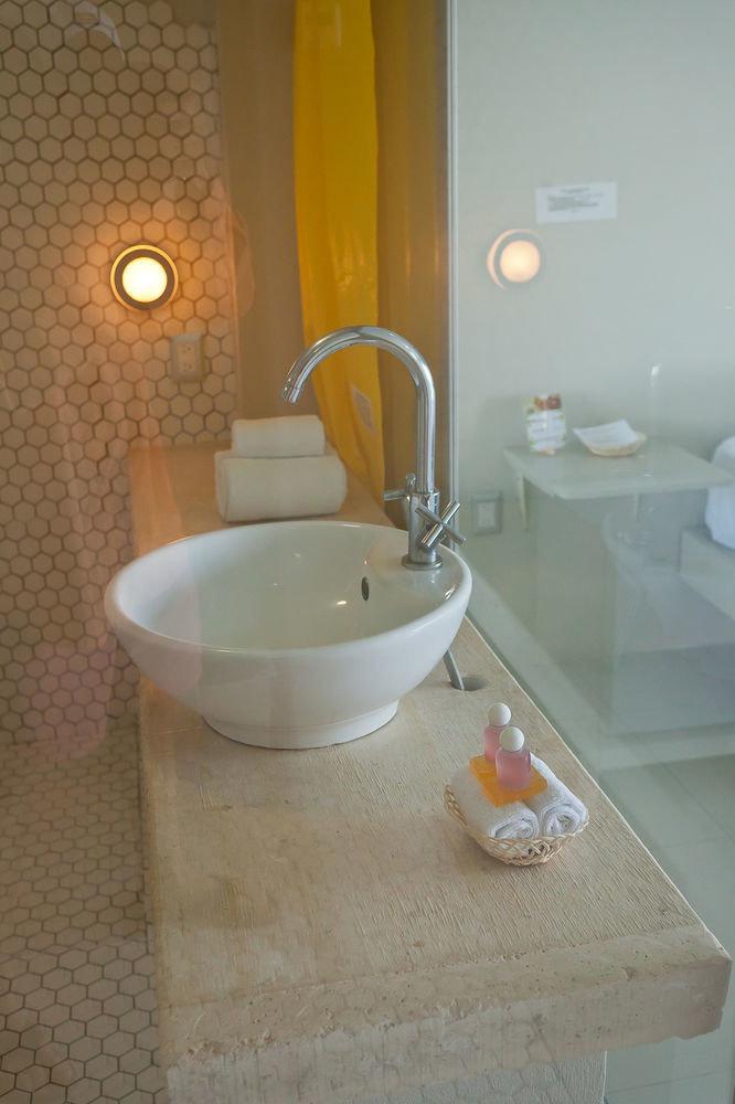 bathroom sink property plumbing fixture flooring bidet ceramic tub Bath bathtub