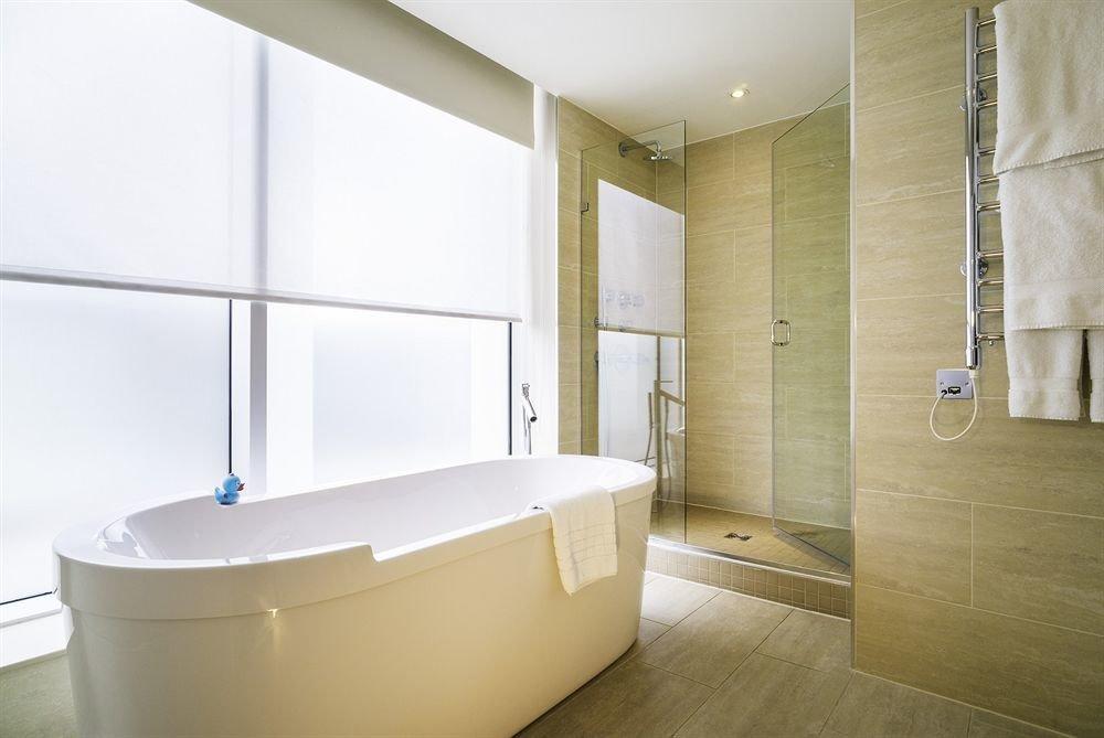 bathroom bathtub plumbing fixture sink bidet flooring public toilet tub Bath tan