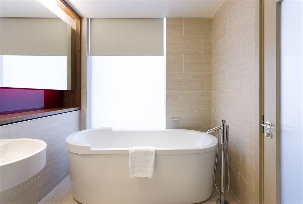bathroom mirror bathtub toilet plumbing fixture sink swimming pool bidet public toilet tub Bath