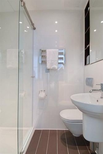 bathroom shower property toilet sink scene glass plumbing fixture bidet flooring tiled stall Bath tub tile bathtub