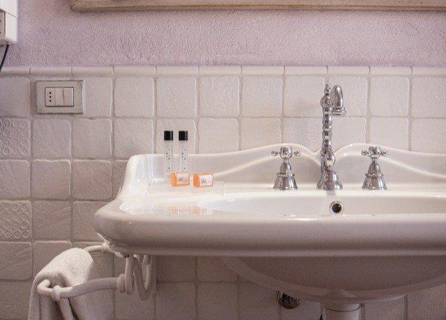 bathroom sink bathtub swimming pool plumbing fixture bidet toilet jacuzzi tile tiled Bath