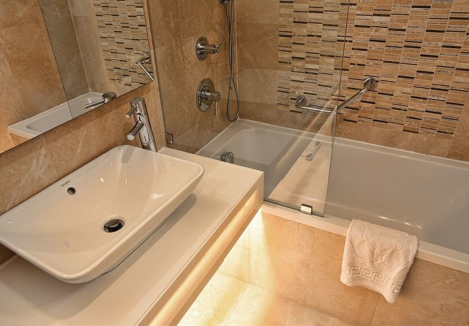 bathroom property bathtub swimming pool plumbing fixture flooring toilet tub bidet sink jacuzzi vessel tile Bath tan tiled