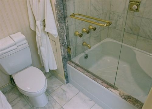 bathroom property plumbing fixture toilet swimming pool bathtub bidet sink flooring rack tiled tile Bath tan